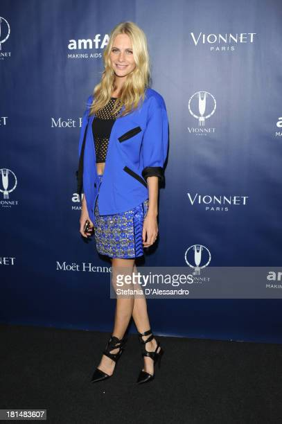 Poppy Delevingne attends the amfAR Milano 2013 Gala after party presented by Vionnet as part of Milan Fashion Week Womenswear Spring/Summer 2014 at...