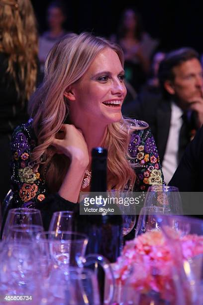 Poppy Delevingne attends the amfAR Milano 2014 Gala Dinner and Auction as part of Milan Fashion Week Womenswear Spring/Summer 2015 on September 20...