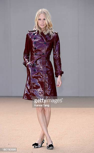 Poppy Delevingne attends the Burberry Prorsum show during London Fashion Week SS14 at Kensington Gardens on September 16 2013 in London England