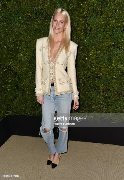 Poppy Delevingne attends the celebration of Chanel's Gabrielle Bag hosted by Caroline De Maigret and Pharrell Williams at Giorgio Baldi on April 6...