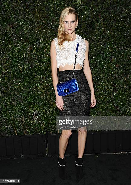 Poppy Delevingne attends the Chanel and Charles Finch preOscar dinner at Madeo Restaurant on March 1 2014 in Los Angeles California