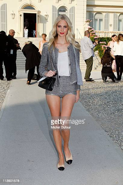 Poppy Delevingne attends the Chanel Collection Croisiere Show at Hotel du Cap on May 9, 2011 in Cap d'Antibes, France.