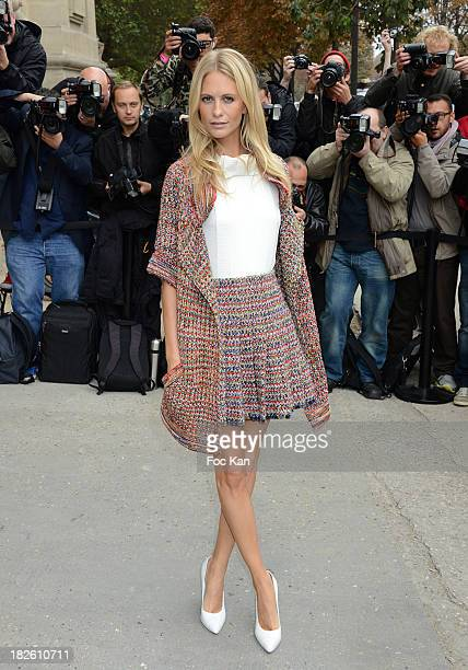 Poppy Delevingne attends the Chanel show as part of the Paris Fashion Week Womenswear Spring/Summer 2014 at the Grand Palais on October 1 2013 in...