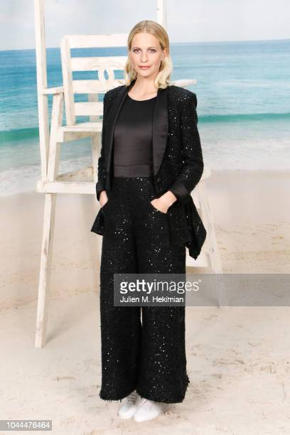 Poppy Delevingne attends the Chanel show at Le Grand Palais as part of Paris Fashion Week Womenswear on October 2 2018 in Paris France