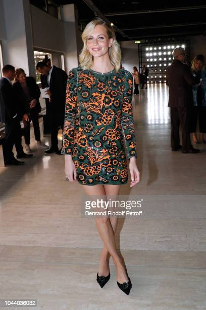 Poppy Delevingne attends the Giambattista Valli show as part of the Paris Fashion Week Womenswear Spring/Summer 2019 on October 1 2018 in Paris France