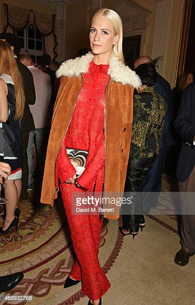Poppy Delevingne attends the London Fashion Week party hosted by Ambassador Matthew Barzun and Mrs Brooke Brown Barzun with Alexandra Shulman in...