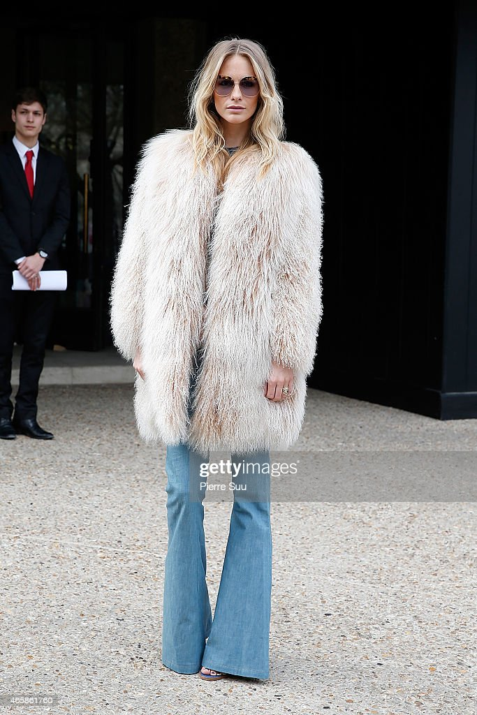 Poppy Delevingne attends the Miu Miu show as part of the Paris Fashion Week Womenswear Fall/Winter 2015/2016 on March 11, 2015 in Paris, France.
