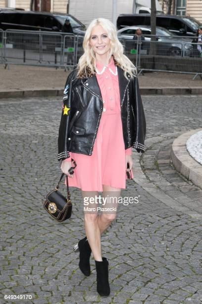 Poppy Delevingne attends the Miu Miu show as part of the Paris Fashion Week Womenswear Fall/Winter 2017/2018 on March 7 2017 in Paris France