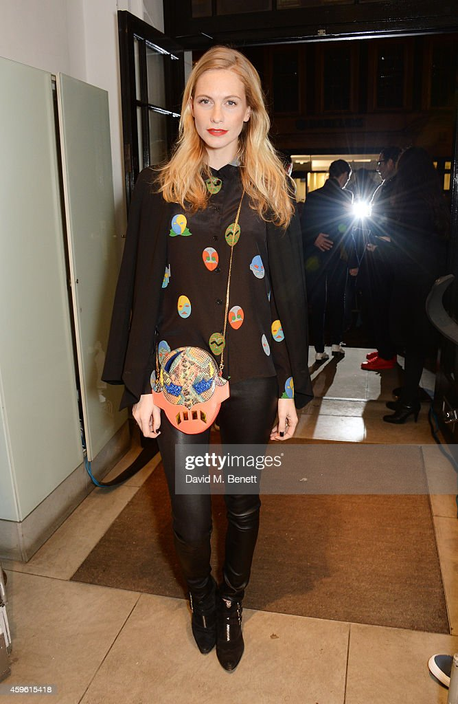 Poppy Delevingne attends the Stella McCartney Christmas Lights Switch On at the Stella McCartney Bruton Street Store on November 26, 2014 in London, England.
