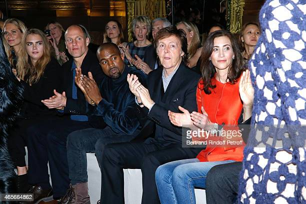 Poppy Delevingne Cara Delevingne Woody Harrelson Kanye West Paul McCartney and his wife Nancy Shevell applause at the end of the Stella McCartney...