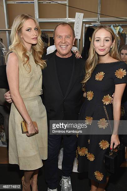 Poppy Delevingne designer Michael Kors and Harley VieraNewton pose backstage at the Michael Kors fashion show during MercedesBenz Fashion Week Fall...