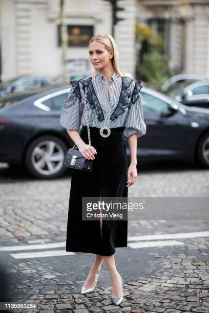 Poppy Delevingne is seen wearing striped blouse high waist skirt with slit outside Miu Miu during Paris Fashion Week Womenswear Fall/Winter 2019/2020...