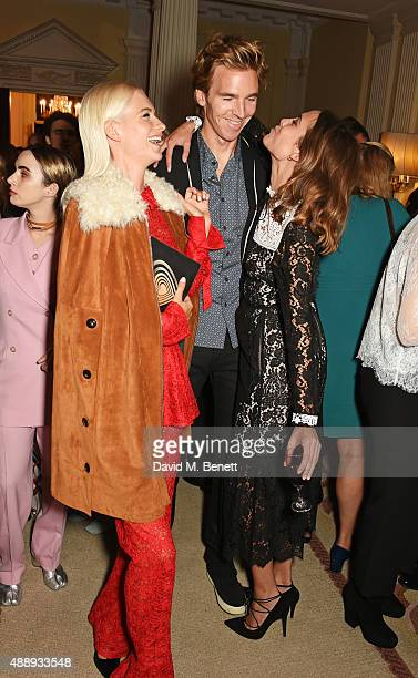 Poppy Delevingne James Cook and Alexa Chung attend the London Fashion Week party hosted by Ambassador Matthew Barzun and Mrs Brooke Brown Barzun with...