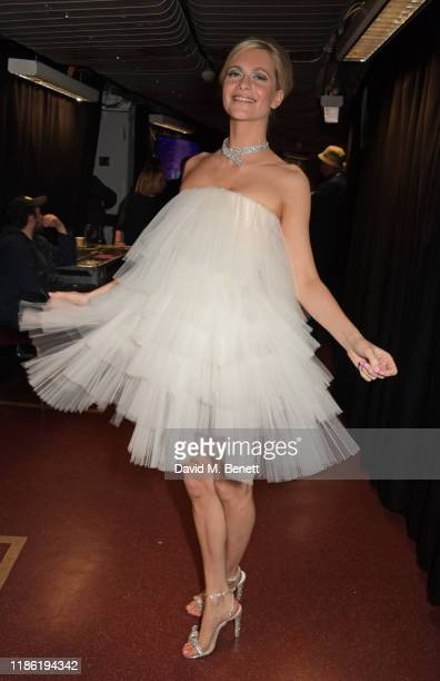 Poppy Delevingne poses backstage stage during The Fashion Awards 2019 held at Royal Albert Hall on December 2, 2019 in London, England.
