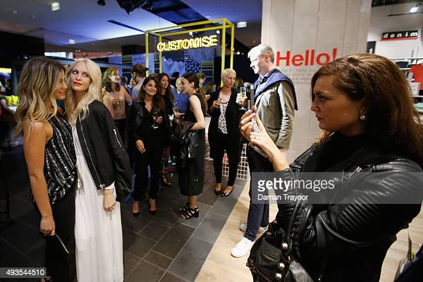 Poppy Delevingne poses for a photo with guests at the launch of the first Australian MRP store at Melbourne Central on October 21 2015 in Melbourne...