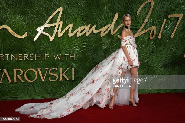 Poppy Delevingne poses on the red carpet upon arrival to attend the British Fashion Awards 2017 in London on December 4 2017 / AFP PHOTO / Daniel...