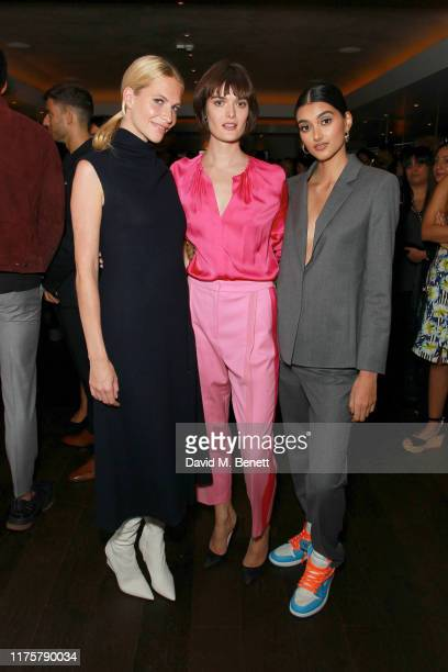 Poppy Delevingne Sam Rollinson and Neelam Gill attend the The 'HUGO BOSS' Boat Christening Ceremony and Cocktail Party on September 19 2019 in London...