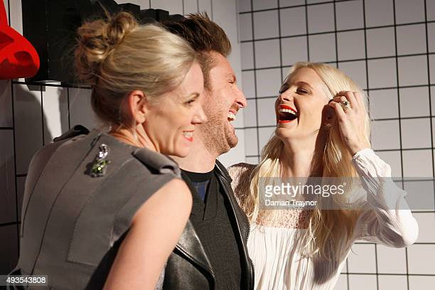 Poppy Delevingne shares a laugh with MRP Foundation ambassador and mentor Henry Holland during the launch of the first Australian MRP store at...