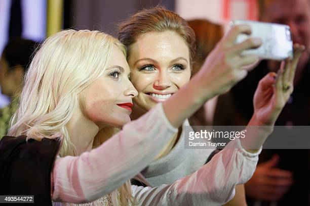 Poppy Delevingne takes a selfie with guests at the launch of the first Australian MRP store at Melbourne Central on October 21 2015 in Melbourne...