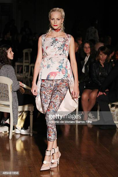 Poppy Delevingne walks the runway at the GILES show during London Fashion Week Spring/Summer 2016/17 on September 21, 2015 in London, England.