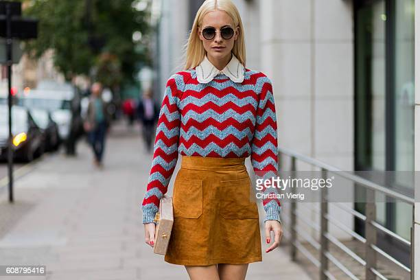 Poppy Delevingne wearing a jumper and skirt outside during London Fashion Week Spring/Summer collections 2017 on September 19 2016 in London United...
