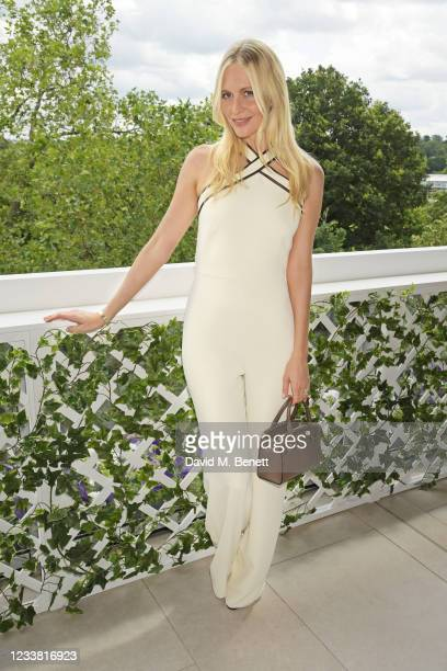 Poppy Delevingne, wearing Ralph Lauren, attends the Polo Ralph Lauren & British Vogue day during Wimbledon at All England Lawn Tennis and Croquet...