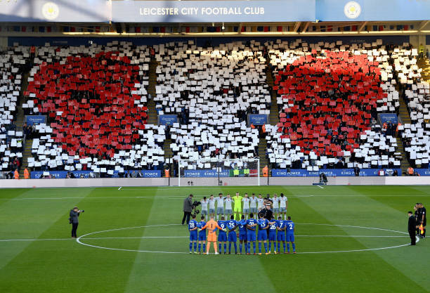 Poppy design is displayed in the crowd as players and officials line up for a minute's silence ahead of Remembrance Sunday prior to the Premier...