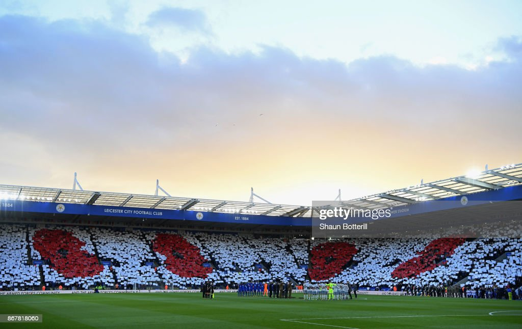 A Poppy design is displayed in the crowd as players and officials line up for a minute's silence ahead of Remembrance Sunday prior to the Premier League match between Leicester City and Everton at The King Power Stadium on October 29, 2017 in Leicester, England.