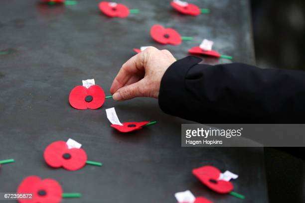 A poppy is laid on the Tomb of the Unknown Warrior during Anzac Day dawn service at Pukeahu National War Memorial Park on April 25 2017 in Wellington...