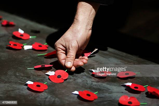 A poppy is laid on the Tomb of the Unknown Warrior during the ANZAC Dawn Ceremony at the Pukeahu National War Memorial Park on April 25 2015 in...
