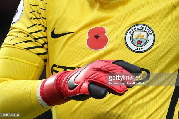 A poppy is seen on the shirt of Ederson of Manchester City during the Premier League match between West Bromwich Albion and Manchester City at The...