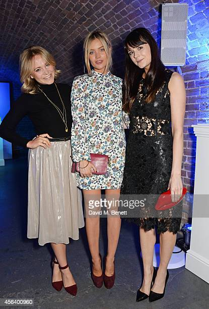 Poppy Jamie Laura Whitmore and Lilah Parsons attend the Disaronno Wears Versace limited edition bottle launch at One Mayfair on September 30 2014 in...