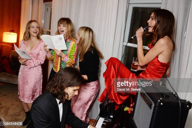 Poppy Jamie Suki Waterhouse Camille Charriere and Alexa Chung wearing ALEXACHUNG sing at Alexa Chung's CHUNGSGIVING dinner to celebrate Thanksgiving...