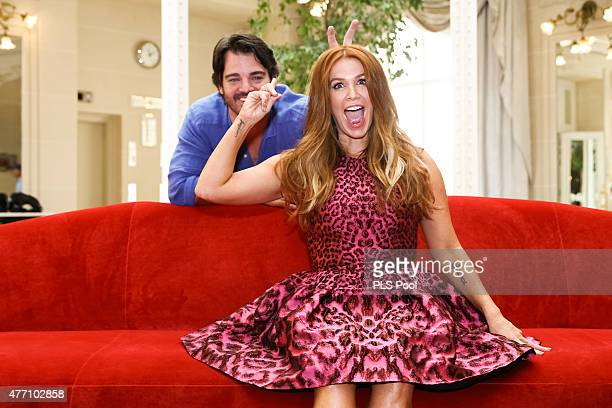 Poppy Montgomery and husband Shawn Sanford pose at a photocall for the TV series 'UNFORGETTABLE' during the 55th Monte Carlo TV Festival on June 14...