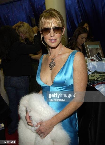 Poppy Montgomery wearing Dior Hippy 1s sunglasses during Solstice Sunglass Boutique at the 2005 People's Choice Awards in Los Angeles CA United States