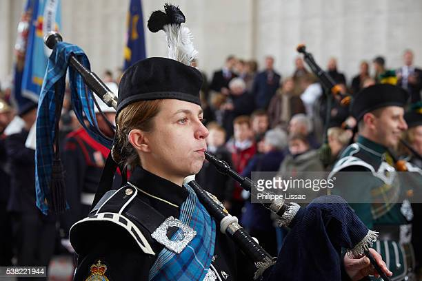 poppy parade in ypres on armistice day. bagpipers - bagpipes stock pictures, royalty-free photos & images