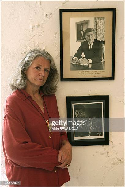 Poppy Salinger near a picture signed by President John Kennedy by the copy of Pierre Salinger's White House desk while working as press secretary of...