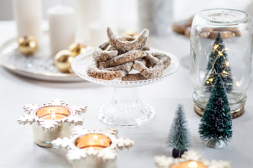 Poppy seed cookies on glass cake stand at Christmas time - gettyimageskorea