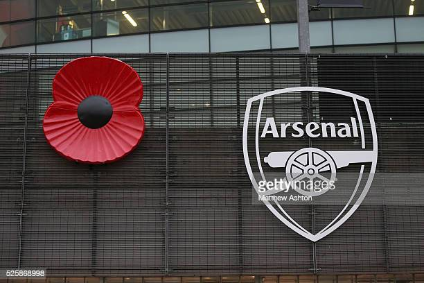 A poppy to mark remembrance day next to the Arsenal badge at the Emirates stadium home of Arsenal
