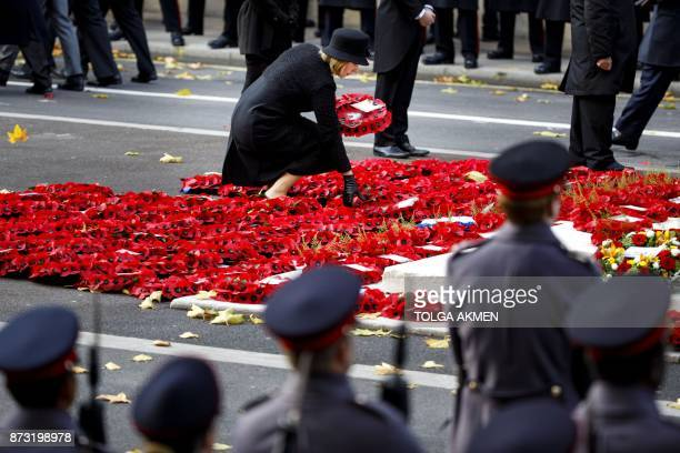 Poppy wreaths are pictured at the Remembrance Sunday ceremony at the Cenotaph on Whitehall in central London on November 12 2017 Services are held...