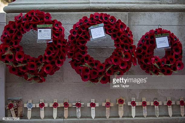 Poppy wreaths are pictured on the Cenotaph on Whitehall following the annual Remembrance Sunday Service on November 13 2016 in London England The...
