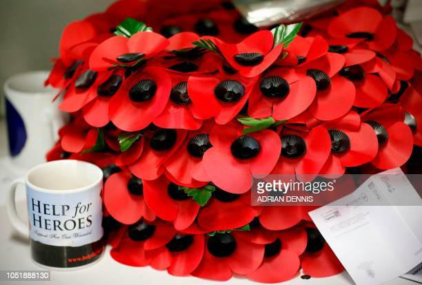 Poppy wreaths are piled on a work bench at The Poppy Factory in Richmond west London on October 11 2018 Remembrance poppies have been made in this...