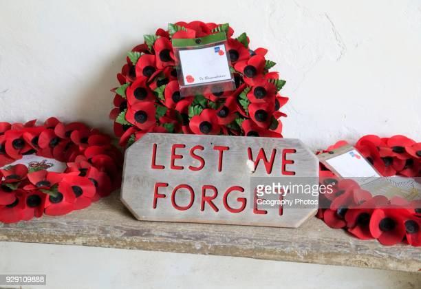 Poppy wreaths remembrance Lest We Forget Church of Saint Bartholomew Orford Suffolk Suffolk England UK