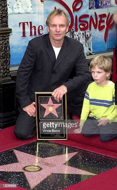 Poprock musician Sting and son Gacomo pose after dad received a star on the famous Hollywood Walk of Fame December 8 2000 on Hollywood Boulevard in...