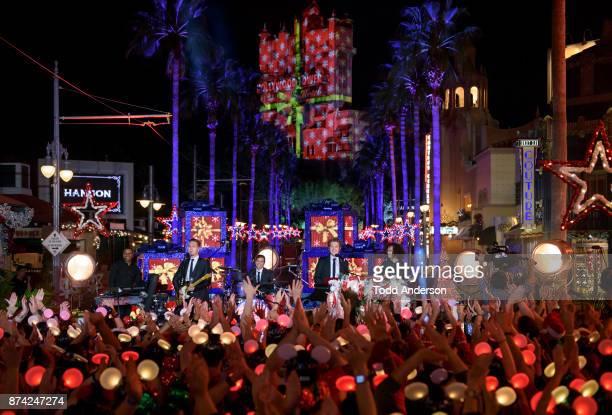 CELEBRATION Poprock trio Hanson performs at Disneys Hollywood Studios at Walt Disney World Resort Friday Nov 3 during a taping for 'The Wonderful...