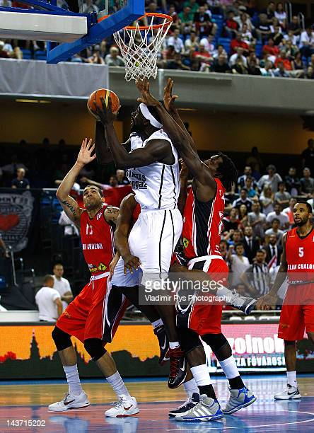 Pops Mensah-Bonsu of Besiktas shoots as Michel Jean-Baptiste-Adolphe and Blake Schilb of Chalon defend during the FIBA Europe EuroChallenge Final...
