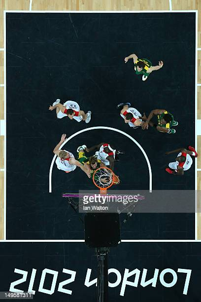 Pops MensahBonsu of Great Britain and Tiago Splitter of Brazil compete for a rebound in the Men's Basketball Preliminary Round match between Great...