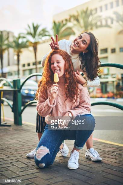 popsicles put the fun in summer - downtown comedy duo stock pictures, royalty-free photos & images