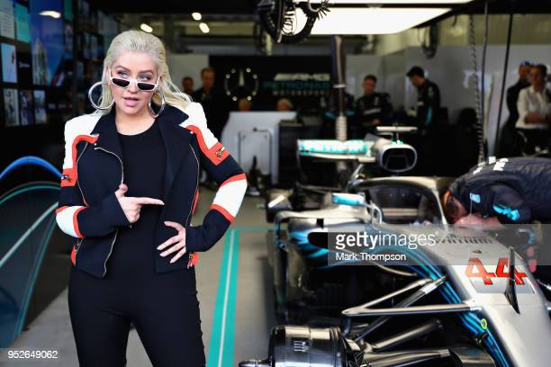 Popstar Christina Aguilera poses for a photo in the Mercedes garage before the Azerbaijan Formula One Grand Prix at Baku City Circuit on April 29...