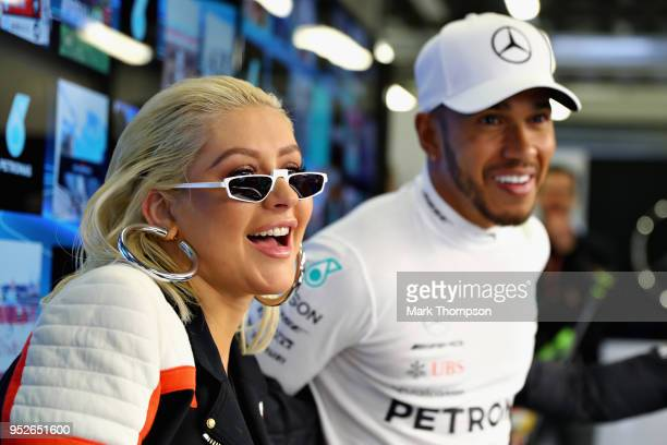 Popstar Christina Aguilera talks with Lewis Hamilton of Great Britain and Mercedes GP in the Mercedes garage before the Azerbaijan Formula One Grand...